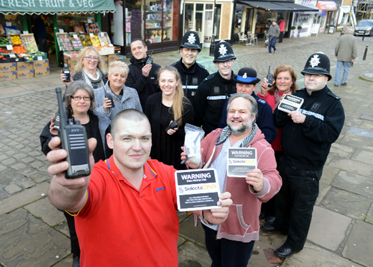 Richard Milner (front left) and Coun David Whipp (right) help launch the anti-crime scheme in Barnoldswick Town Square