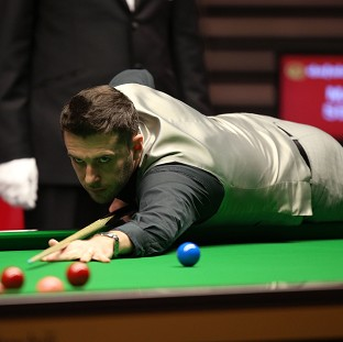 Mark Selby, pictured, battled from 5-3 down to beat John Higgins 6-5