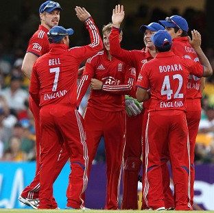 England players celebrate the wicket of Australia's Michael Clarke during the second ODI at the Gabba (AP)