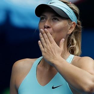 Maria Sharapova blows kisses to the crowd after defeating Alize Cornet in their third round match at the Australian Open tennis championship (AP)