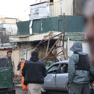 Burnley and Pendle Citizen: Afghan security forces investigate the suicide attack in Kabul, Afghanistan (AP)