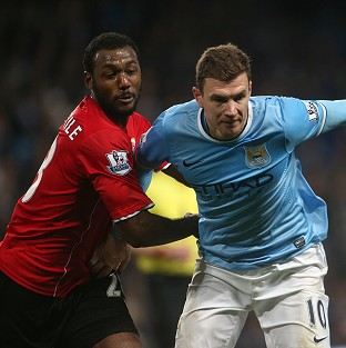 Edin Dzeko, right, wants to win trophies at Manchester City