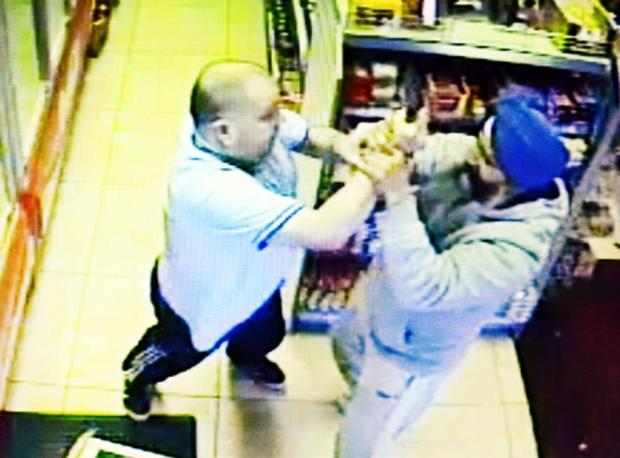 The dramatic moment when shopkeeper Bhag Singh tackled knifeman Anthony Doran, caught on CCTV
