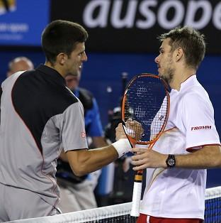 Stanislas Wawrinka, right, overcame Novak Djokovic in five sets (AP)