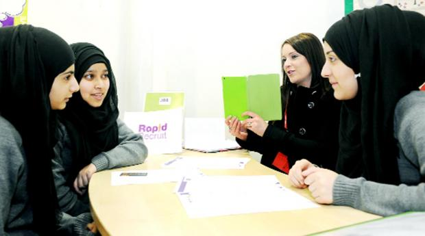 Burnley and Pendle Citizen: From left, students Sidrah Naeem, 16, and Aneesha Begum, 15, are interviewed. Patricia Laughlin, recruitment consultant, Rapid Recruit, videos a mock interview, which is led by Sundhas Ahmed, 15.