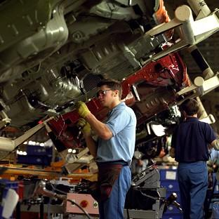 Car workers on a production line, as it was revealed that predicted output in the industry will reach record levels by 2017
