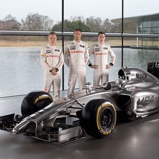 McLaren drivers Kevin Magnussen, left, Jenson Button, centre, and Stoffel Vandoorne at the launch of the MP4-29 (McLaren/PA)