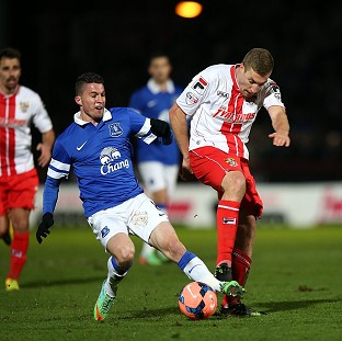 Bryan Oviedo, left, breaks his leg during a challenge with Simon Heslop