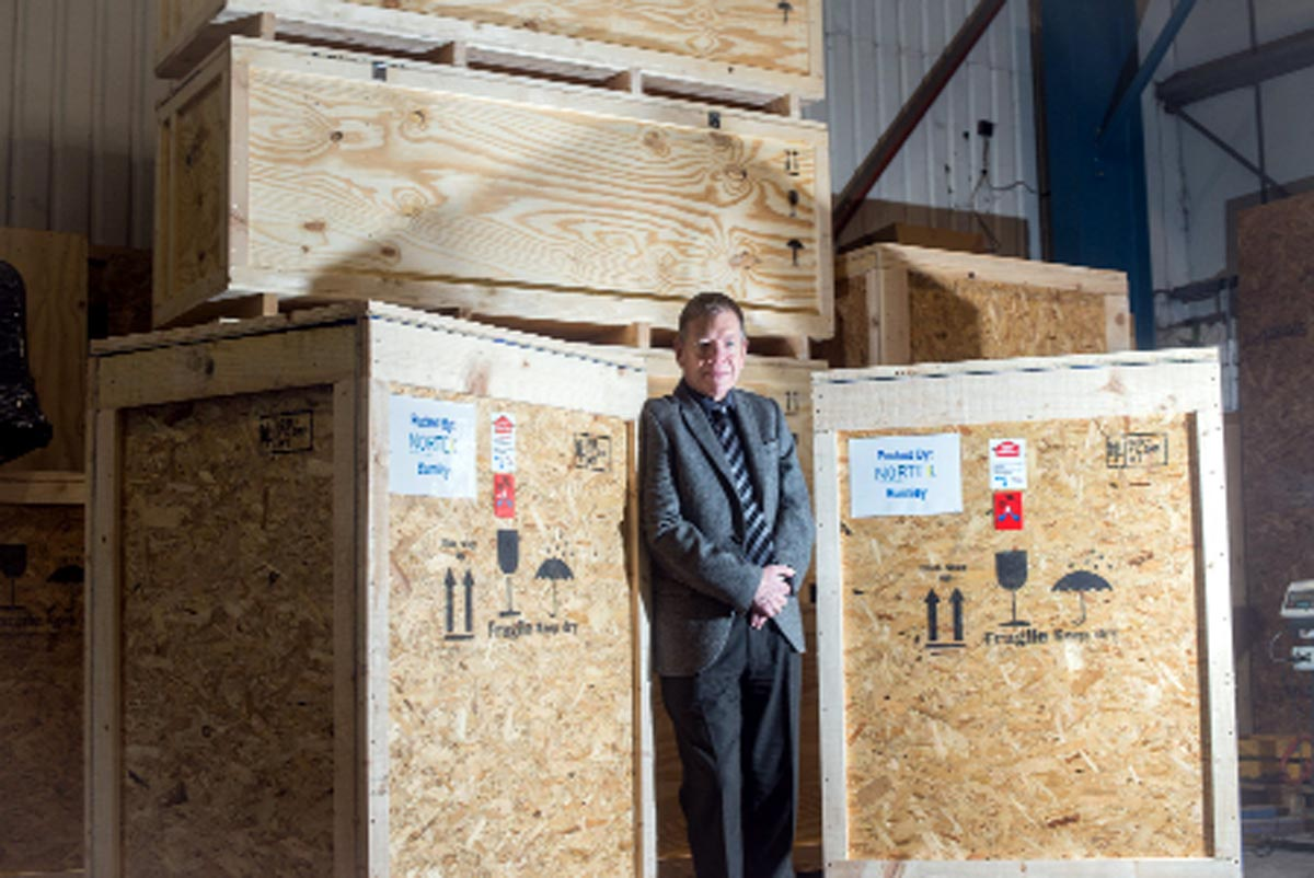 Above, Nortex managing director Stephen Sadler prepares the containers for shipping to the island of St Helena