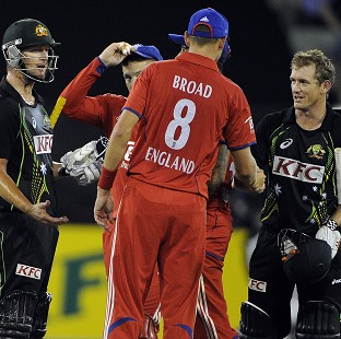 Stuart Broad, centre, congratulates George Bailey and Cameron White after Australia clinched the T20 series (AP)