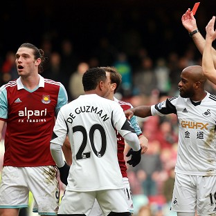 Andy Carroll, left, was sent off by Howard Webb