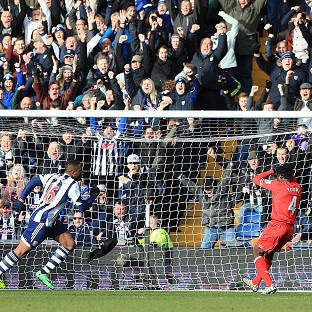 Victor Anichebe, centre, wheels away after scoring the equaliser
