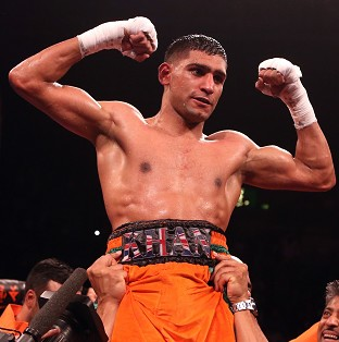 Amir Khan, pictured, hopes to face Floyd Mayweather
