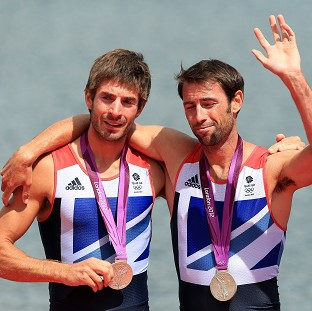 Zac Purchase, left, has retired from rowing