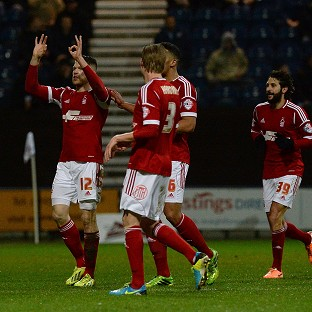 Jamie Mackie, left, celebrates the opening goal