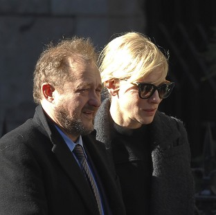Actress Cate Blanchett and her husband Andrew Upton arrive for the private funeral of actor Philip Seymour Hoffman