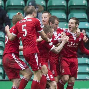 Peter Pawlett, right, celebrates the winning goal