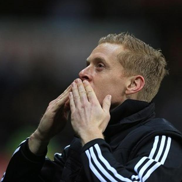 Burnley and Pendle Citizen: Garry Monk acknowledges the Swansea fans after masterminding a 3-0 win over Cardiff