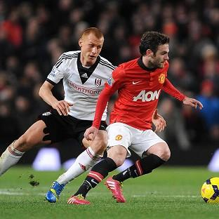 Manchester United's Juan Mata, right, has demanded the team improve