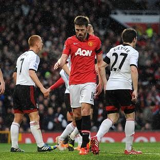 Michael Carrick, centre, scored a late goal against Fulham but Manchester United could still only draw