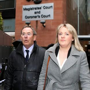 Burnley and Pendle Citizen: Fred Talbot leaves Manchester Magistrates Court with an unidentified woman, where the TV weatherman is charged with nine counts of indecent assault and a sexual assault.