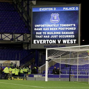 Everton's home game with Crystal Palace was called off after high winds had caused damage to buildings in the area