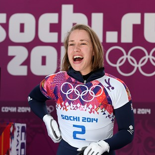 Lizzy Yarnold celebrates after her second run in Sochi