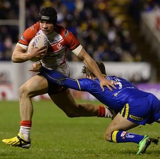 Burnley and Pendle Citizen: Jonny Lomax is tackled by Warrington Wolves' Richie Myler