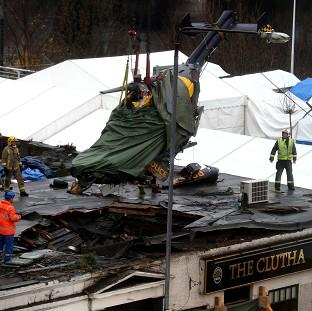 The wreckage of the police Eurocopter is lifted from t