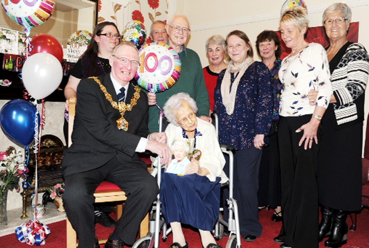The mayor and other guests at Sally's 100th birthday party