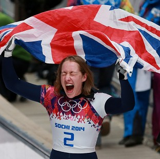 Lizzy Yarnold savours the moment after winning gold