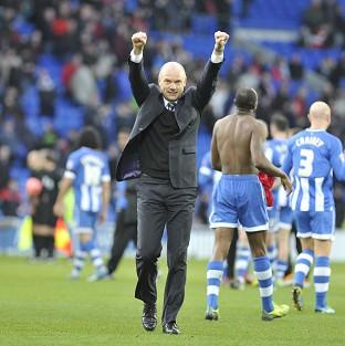 Wigan boss Uwe Rosler celebrates at the final whistle