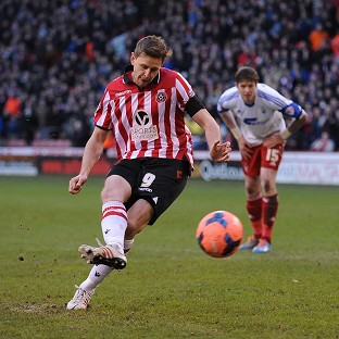 Chris Porter converts a penalty for Sheffield United