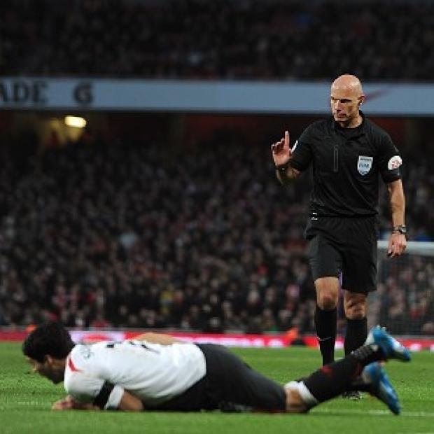 Burnley and Pendle Citizen: Howard Webb came under criticism for his handling of the FA Cup tie