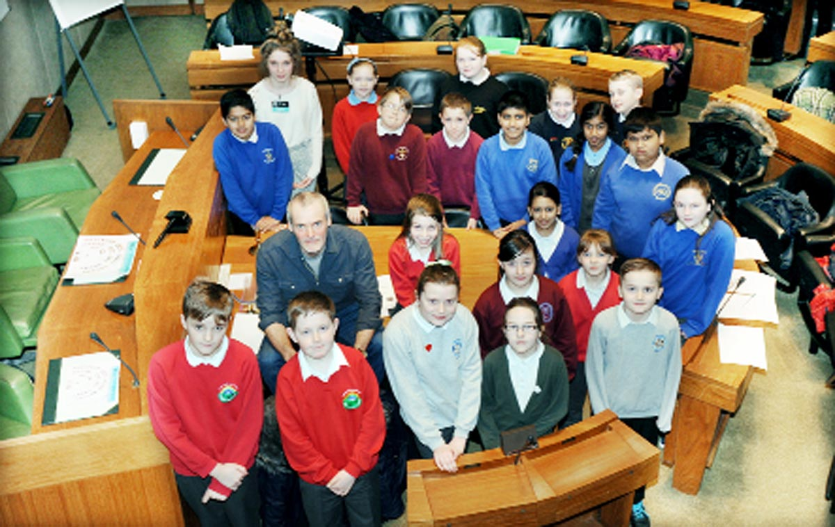 Mike Townsend with schoolchildren at Burnley Town Hall where he spoke to them about adopting a soldier