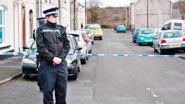 Police at the scene after a baby died in Wales
