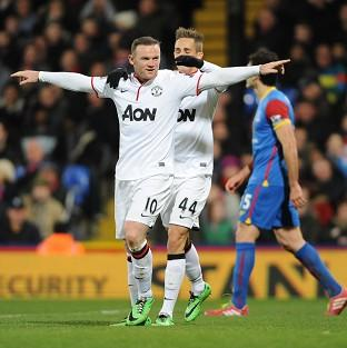 Wayne Rooney, left, celebrates scoring Manchester United's second goal