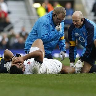 Billy Vunipola receives treatment from medical staff