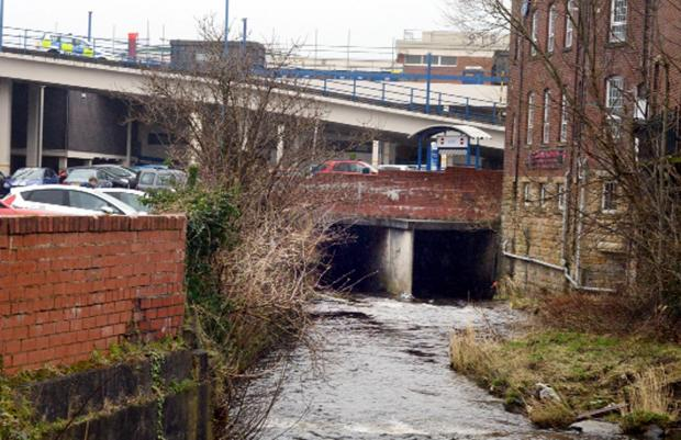 An unconscious man was rescued from the riverbank near McDonald's in Burnley