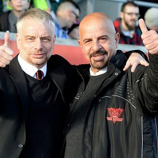 Salford Red Devils coach Brian Noble, left, is backing his owner Marwan Koukash's radical salary-cap plan