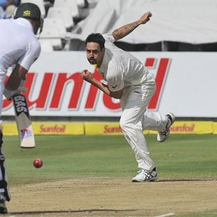 Mitchell Johnson, right, took four wickets in South Africa's first innings to give his side the ascendancy (AP)