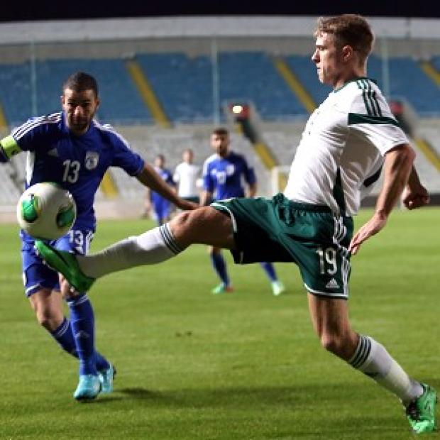Burnley and Pendle Citizen: Cyprus' Konstantinos Makridis, left, and northern Ireland's Jamie Ward battle for the ball (AP)