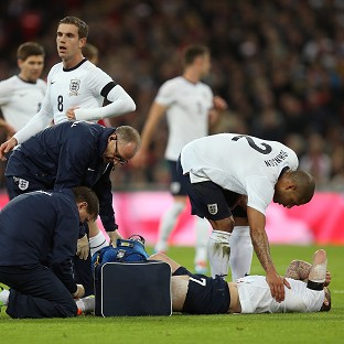 Jack Wilshere is treated by medical staff