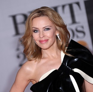 Kylie Minogue thinks male pop stars get away with more than female ones