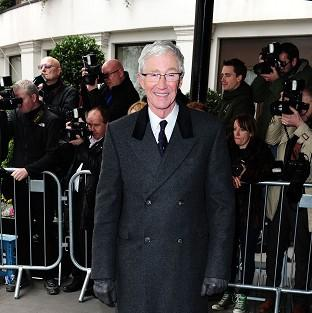 Paul O'Grady arrived at the Tric Awards by taxi bike