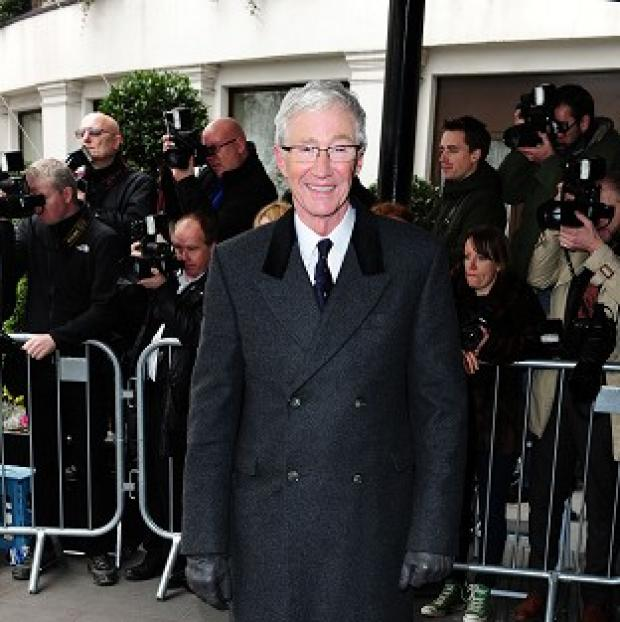 Burnley and Pendle Citizen: Paul O'Grady arrived at the Tric Awards by taxi bike