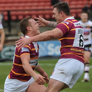 Huddersfield ran in 12 tries on their way to a convincing victory over Bradford