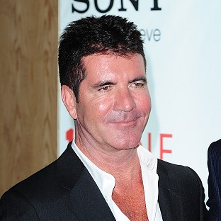 Simon Cowell took his son to meet his mum