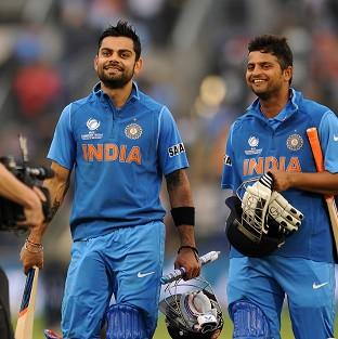 Burnley and Pendle Citizen: Virat Kohli, left, and Suresh Raina helped India on their way to victory over arch-rivals Pakistan
