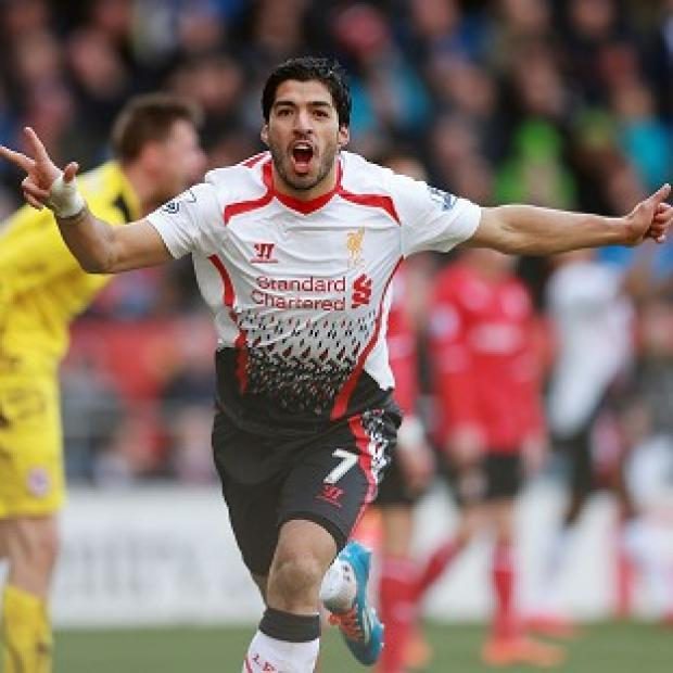 Burnley and Pendle Citizen: Luis Suarez scored a superb hat-trick in Liverpool's 6-3 success